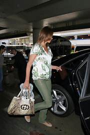 Cindy sure has a thing for snakeskin, this Gucci bag is just one of her exotic skinned bag collection.