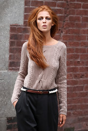 Cintia Dicker worked a photo shoot wearing one of Jayson Brundson's creation: a comfy gray knit sweater.