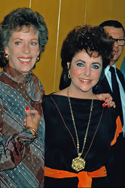Elizabeth Taylor accessorized with an eye-catching gold pendant necklace.