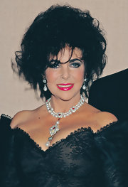 Elizabeth Taylor's pearl, diamond, and ruby necklace and matching earrings were real stunners.
