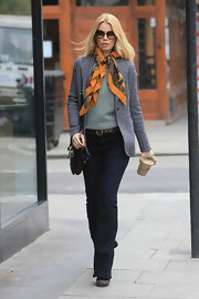 Claudia wears a dark denim jean with her put-together ensemble for a stop at Starbucks.