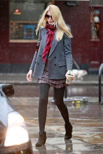 Nothing keeps Claudia from her Starbucks, or her fashionable attire! Claudia beats the rain in a gray blazer and brightly colored scarf.
