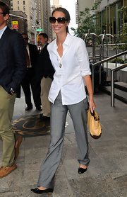 When you're tall like supermodel Christy Turlington, you don't need high heels with your cuffed trousers!