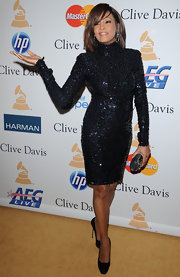 Whitney Houston looked stunning wearing a turtleneck sequined dress at the pre-Grammy party.