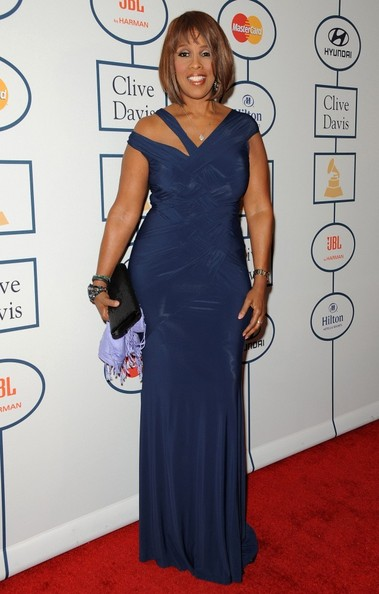 Gayle King looked sophisticated in a blue evening dress with an asymmetrical neckline during Clive Davis' pre-Grammy gala.