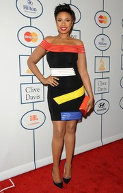 Jennifer Hudson looked chic and modern in a multicolored off-the-shoulder dress by Christopher Kane during Clive Davis' pre-Grammy gala.