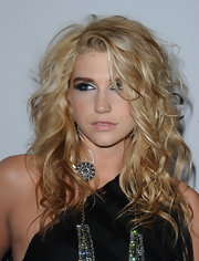 Kesha showed off radiant blond curls at the Pre-Grammy Gala. She completed her look with shimmering shadow.