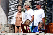 George Clooney and Elisabetta Canalis enjoy the sun whilst on vacation.