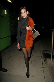 Alexa Chung styled her LBD with a faux fur scarf in a fiery orange hue.