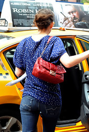 Marion Cotillard showed off a fiery red quilted bag while catching a cab in SoHo.