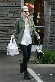 Miley channeled a military vibe by pairing her army green button-down with a deconstructed tank.