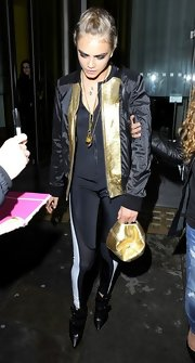 Cara DeLevigne was seen at the DKNY event wearing a two-toned zip-up jacket.