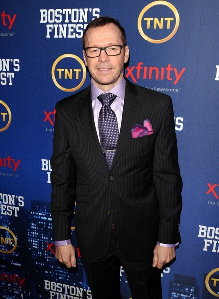 Donnie Wahlberg added some color to his black pin stripe suit with a light purple button down and purple dotted tie.