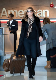 Daisy Fuentes wore a leopard print scarf with her chic black airport ensemble for her travels at LAX.