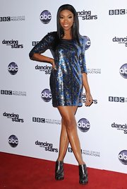 Brandy donned pewter ankle boots with her blue and gray metallic dress. The look drew attention to the singer's dancer legs.