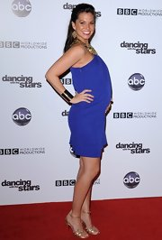 A pregnant Melissa Rycroft posed in strappy gold heels. The heels matched her dress's gold built in necklace.