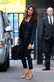 Danielle Bux chose a sleek two-button suit in a rich navy color for her look while out at the London Studios.