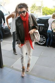 Dannii dons a bold red gauzey scarf while out in London.