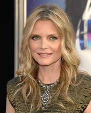 Michelle Pfeiffer added another layer of glamour to her look with this ornate diamond chandelier necklace.