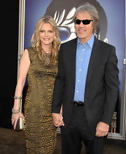 Michelle Pfeiffer glowed at the 'Dark Shadows' premiere with this gold cocktail dress and metallic clutch combo.