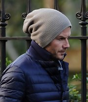 Soccer stud David Beckham knew just how to beat the winter temps with a simple gray beanie.