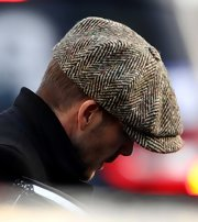 David Beckham looked anything but casual in this classic tweed newsboy cap while walking the London streets.
