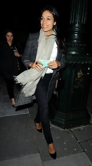 Rosario Dawson chose a classic tweed coat for her look while out at the 'David Bowie Is' event.