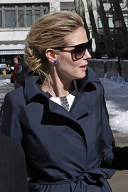 Heidi wore a sophisticated messy updo with lots of texture and a twisted design.