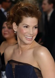 Sandra Bullock finished off her look with a tousled curly updo.