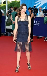 Astrid Berges-Frisbey paired a strappy open-toe black sandal with her semi-sheer dress at the Closing Ceremony of the 38th Deauville American Film Festival.