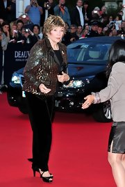 Shirley MacLaine's black velvet trousers paired perfectly with her sparkly top.