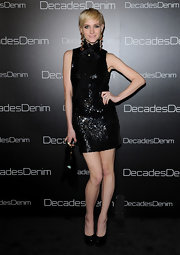 Ashlee shows off her bright blond pixie cut in this bow embellished sequined little black dress.