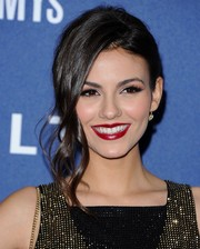 Victoria Justice looked gorgeous at the Delta Air Lines Grammy party wearing this romantic updo with wavy tendrils down one side.