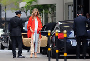 Delta Goodrem made a grand entrance at the Beverly Hills Hotel in a diva-worthy red evening coat.
