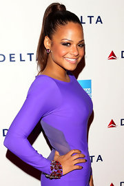 Christina Milian wore her hair in a sleek wrapped ponytail at the Delta Party at Getty House.