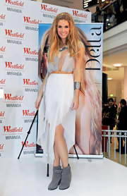 Delta Goodrem looked sassy in a gauzy dress with a colorful bodice and a handkerchief hem during a performance at a Sydney mall.