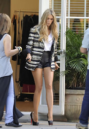 Delta Goodrem balanced a lot of exposed leg with a long tweed boyfriend blazer.
