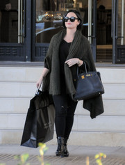 Demi Lovato went shopping at Barneys all bundled up in a bulky shawl-collar cardigan.