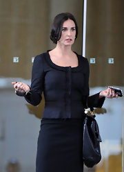 Demi Moore looked sleek on set in a black textured jacket with a deep scoop neck.