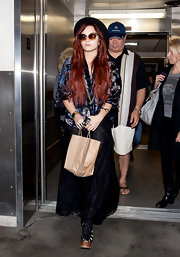 Demi Lovato fully embraced her new boho aesthetic in a velvet burnout blouse and a long black skirt.