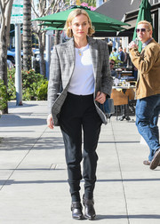 Diane Kruger stepped out in LA looking masculine-chic in a patterned gray blazer.