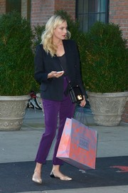 Diane Kruger was spotted out and about wearing a pair of high-waist purple pants.