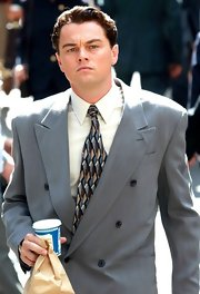 Leonardo DiCaprio spruced up his gray suit with a colorful geometric-print tie on the set of 'The Wolf of Wall Street.'