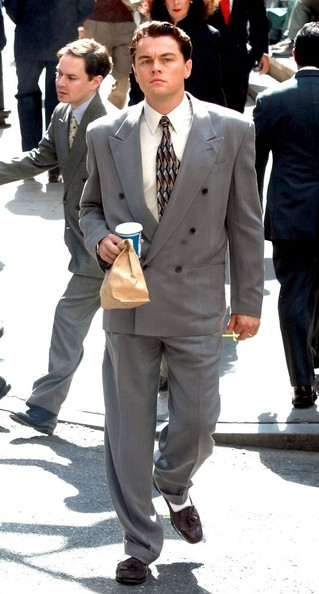 Leonardo DiCaprio donned brown tassel loafers with a gray suit for a 'Wolf of Wall Street' scene.