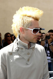 Jared stood out with a bold, platinum mohawk and white shield sunglasses.