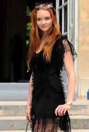 Lily wore a classic gold watch with her lacy, black ensemble.