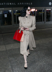 Dita Von Teese looked impeccable, as always, in a beige trenchcoat as she arrived on a flight at LAX.