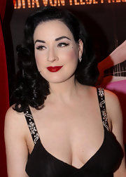 The sultry Dita Von Teese showed off her signature black curls while appearing at a promotional event.