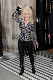 Dolly wore leather leggings with an edgy country-inspired fringe overlay.