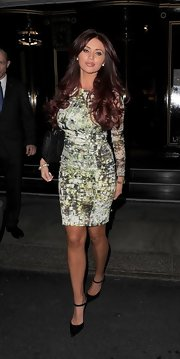 Amy Childs sported a marble-print dress for her evening look while out in London.